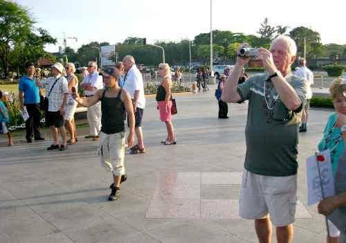 Tourists taking mementos