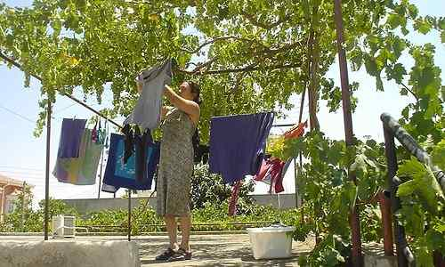 Filipina wife doing her laundry chore